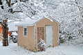 Snow on the shed image of a storage in winter Stock Image