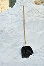 Snow shovel next to pile snow Royalty Free Stock Photo