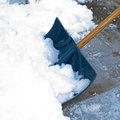 Snow shovel shoveling after a winter storm Stock Photos