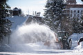 Snow thrower tracktor cleaning streets of resort village in high tatra mountains Stock Image