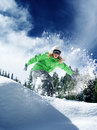 Snow time ride view of a young girl snowboarding in winter environment Stock Photo