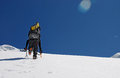 Snow wall climber climbs the of mountains titnuld Stock Photography