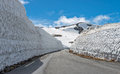 Snow wall on the road Tindevegen. Royalty Free Stock Photo