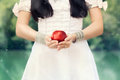 Snow white princess with the famous red apple Stock Photos