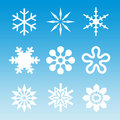 Snow - White Snowflakes On Blue Stock Photo