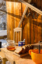 Snow winter cottage breakfast on wooden table tea honey and cake Royalty Free Stock Photography