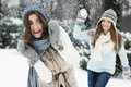 Snowball fight young women have fun during the Stock Images