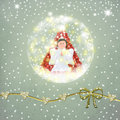 Snowball glass with an angel and a christmas tree inside on textured gold ornaments Stock Photography