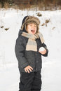 Snowball s too cold toddler boy screaming because holding a snow ball in the hand for first time and it is Royalty Free Stock Photography