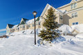 Snowbank a giant in front of a north american building Royalty Free Stock Image