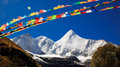 Snowberg and Prayer flags Royalty Free Stock Photo