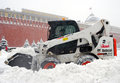 Snowblower clears snow covered red square moscow extreme snowstorm moscow taken march moscow russia Stock Photo