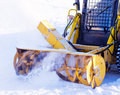 Snowblower removes snow from the tracks Stock Image