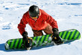 Snowboarder climbing snow slope Stock Photography