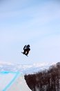 Snowboarder Going Off A Big Ju...