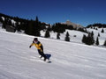 Snowboarder having fun freeriding down on the snow Stock Images