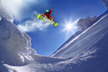 Snowboarder jumping against blue sky Royalty Free Stock Photos