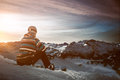 Snowboarder makes a break in the snowy mountains Stock Photos