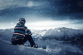 Snowboarder makes a break in the snowy mountains Royalty Free Stock Image