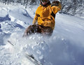Snowboarder moving down freerider in snow powder Stock Photography