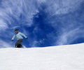 Snowboarder on off piste slope and blue sky with clouds Royalty Free Stock Images