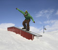 Snowboarder in park man snowboard on slide box for snowboarding mountains Stock Images