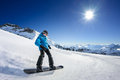 Snowboarder on piste in high mountains Royalty Free Stock Photos