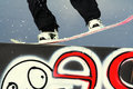 Snowboarder on rail Stock Photography