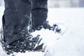 Snowboarder shoe latches close up of snowboard with connecting the skiers feet and ankle securely in the snow Royalty Free Stock Photo