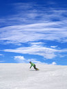Snowboarder on ski slope and blue sky with clouds in nice day Stock Photo
