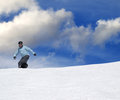 Snowboarder on ski slope at nice day Stock Image