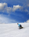 Snowboarder on ski slope at nice sunny day Royalty Free Stock Image