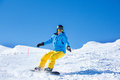 Snowboarder sliding down the hill Stock Photo