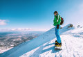 Snowboarder stay on the mountain top Royalty Free Stock Photo