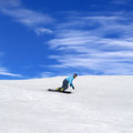 Snowboarder in winter mountains at nice sunny day Stock Photography