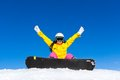 Snowboarder woman sitting on snow mountain slope Royalty Free Stock Photo