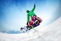 Snowboardind snowboarder jumping from the mountaint along the road extreme Royalty Free Stock Images