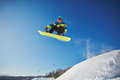 Snowboarding at resort portrait of sportsman against blue sky Royalty Free Stock Images