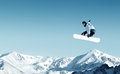 Snowboarding snowboarder making jump high in clear sky Stock Photos