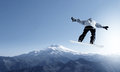 Snowboarding snowboarder making jump high in clear sky Royalty Free Stock Photography
