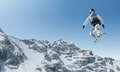 Snowboarding snowboarder making jump high in clear sky Royalty Free Stock Photos