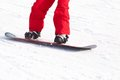 Snowboarding unrecognizable snowboarder on ski resort Royalty Free Stock Photography