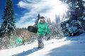 Snowboarding view of a young girl in winter environment Stock Photo