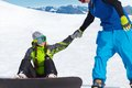 Snowboarding young couple snowboarders in a ski resort Royalty Free Stock Photo
