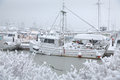 Snowbound steveston harbor richmond british columbia a lone fishboat tied to the dock waiting out a winter snowstorm canada Royalty Free Stock Photo