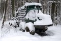 Snowbound timber vehicle Stock Photography