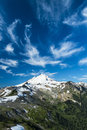 Snowcapped mount baker under high cirrus clouds beautiful washington state cascades Stock Image