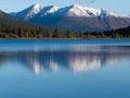 Snowcapped mountain reflection on Lapie Lake Yukon