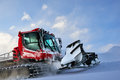 Snowcat rides to work in the evening Royalty Free Stock Photo