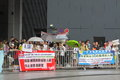 Snowden gains support from protesters in hong kong several hundred demonstrators took to kongs streets the rain saturday voicing Royalty Free Stock Images